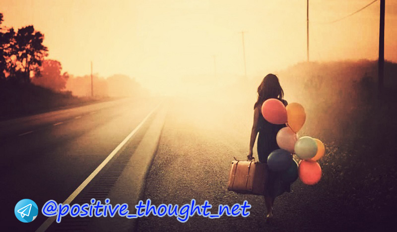 woman-walking-along-the-road-with-suitcase-and-balloons.jpg