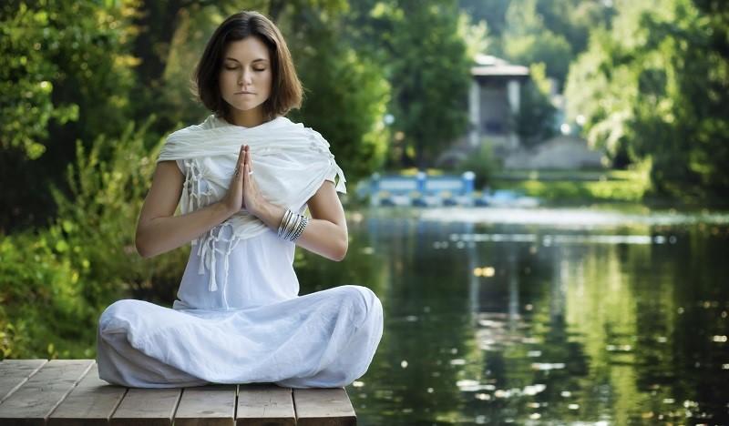 woman-meditating-by-lake-.jpg